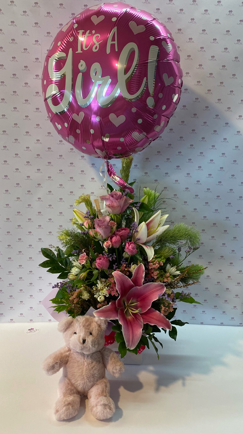 A beautifully crafted pinks arrangement, helium balloon and the softest teddy bear to welcome a precious little newborn.